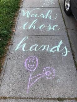Sidewalk chalk says wash those hands