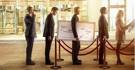 People standing in line at a bank.
